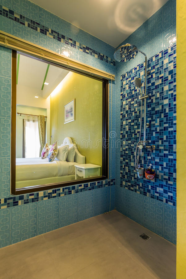 Modern style of bathroom,shower on blue pattern wall stock image