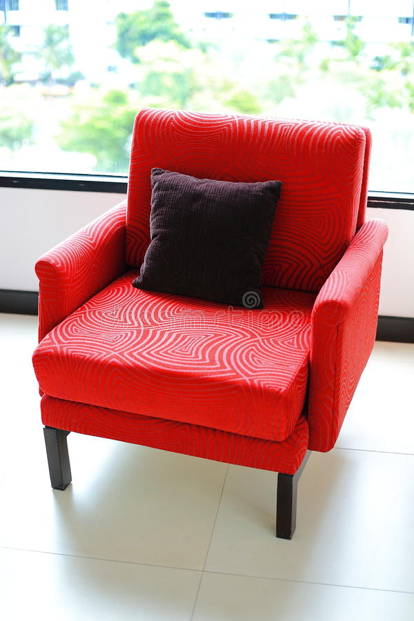 Modern style chair. The red sofa in modern style stock photo