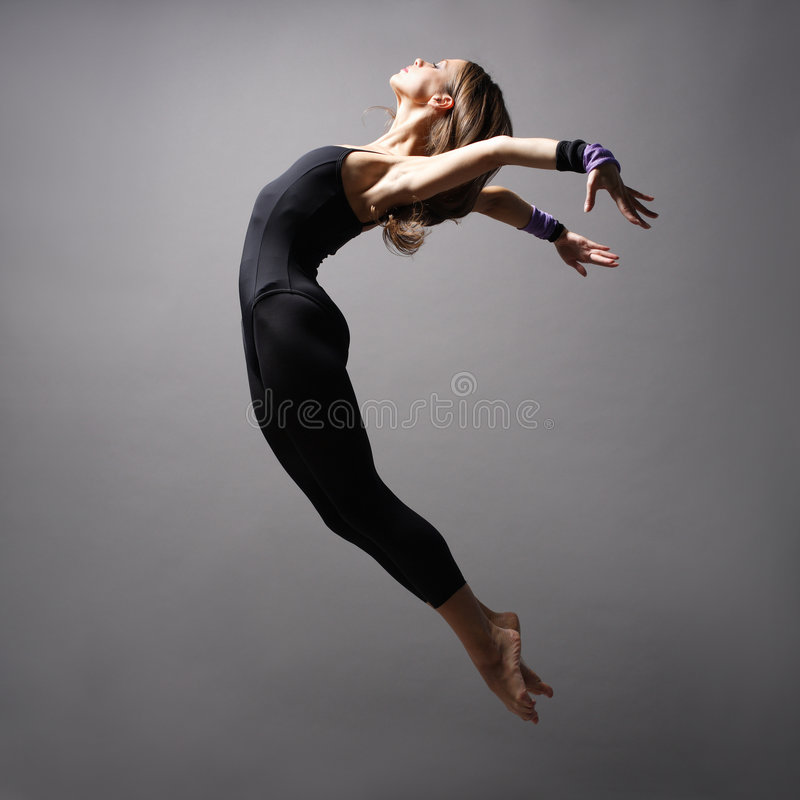 Modern style dancer. Young modern style dancer posing royalty free stock images