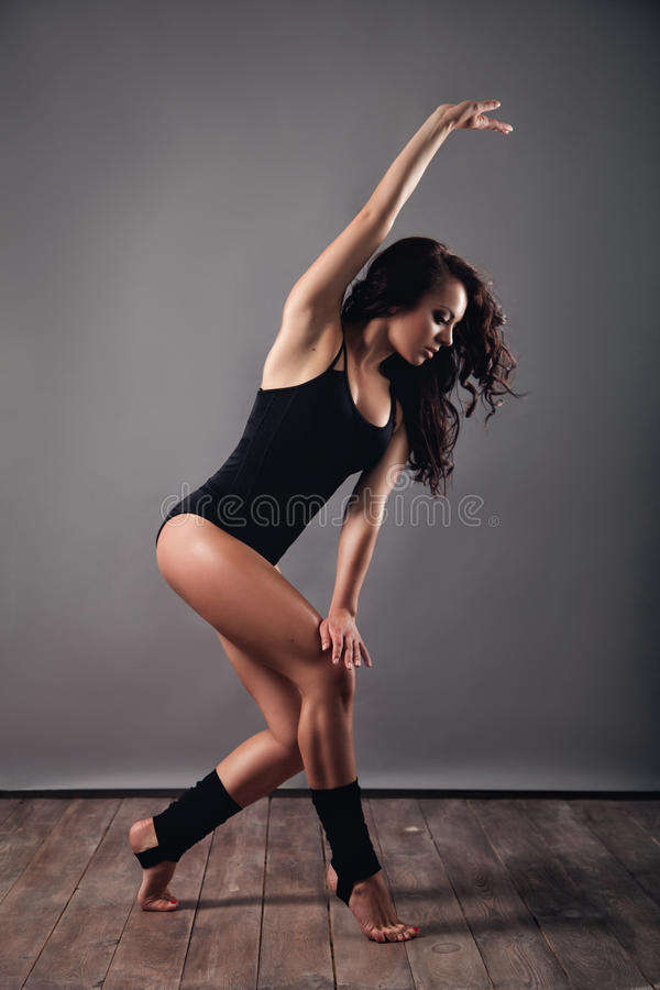 Modern style female dancer in studio stock image