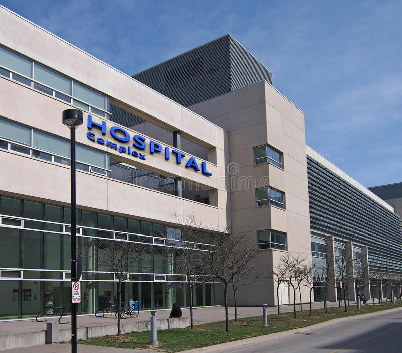 Modern hospital style building. Modern style hospital building, with straight lines and concrete facing stock images