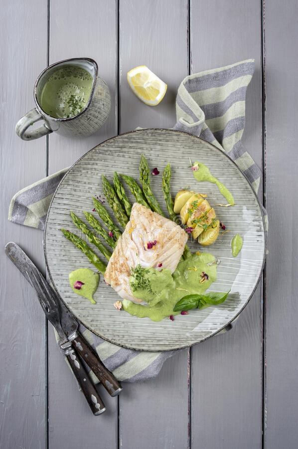 Free Modern Style Traditional Fried Skrei Cod Fish Steak With Green Asparagus And Potatoes On A Nordic Style Plate Stock Image - 215691541