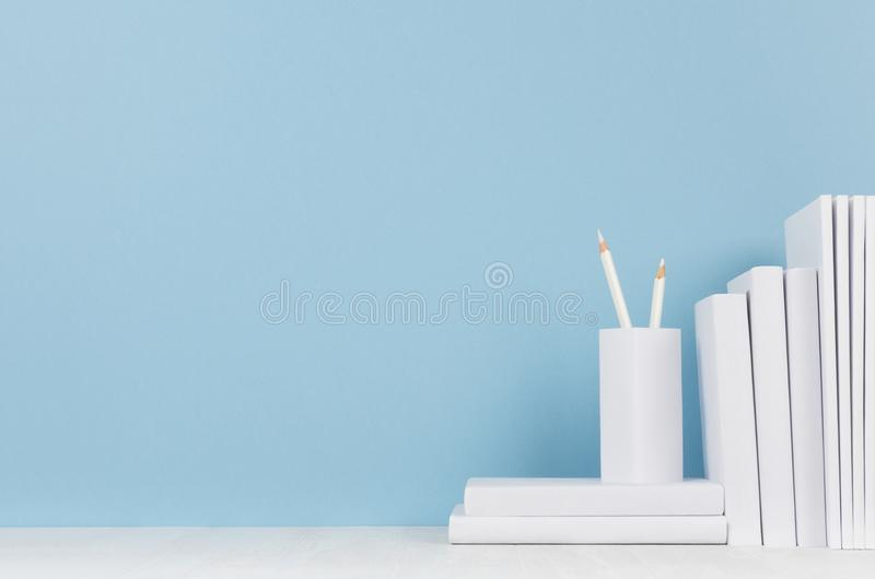 Modern style workplace - white stationery on soft blue background and light desk with copy space. Modern style workplace - white stationery on soft blue stock image