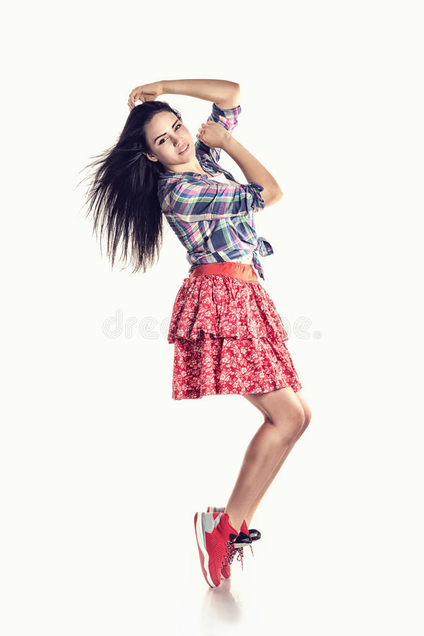 Modern style young girl dancer posing on studio background royalty free stock photo