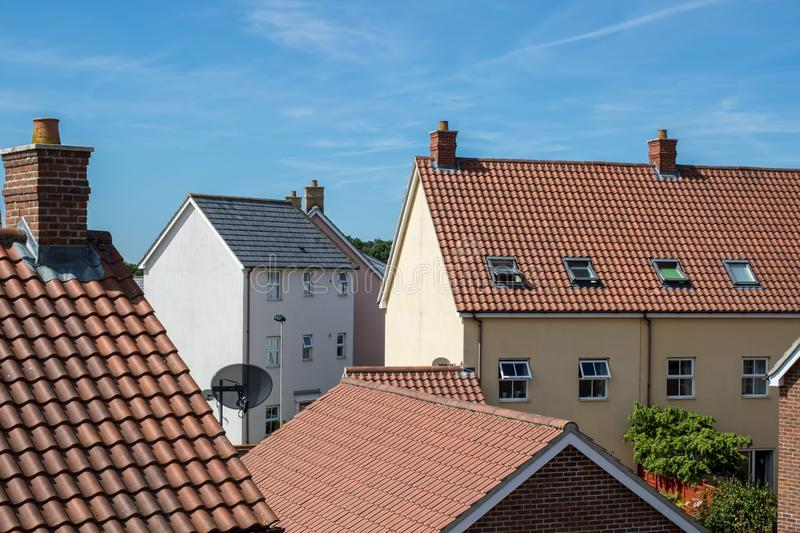 Modern suburban crowded housing estate buildings. Urban house roof tops. View of a variety of contemporary town homes royalty free stock photography