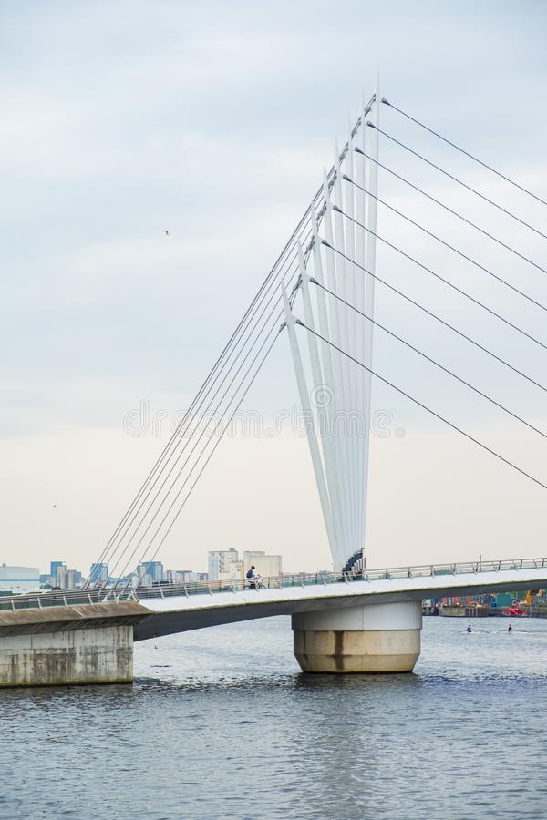 Modern suspended bridge at the Salford Quays on the banks of the Manchester Ship Canal in Salford and Trafford, Greater Manchester. Manchester, United Kingdom royalty free stock image
