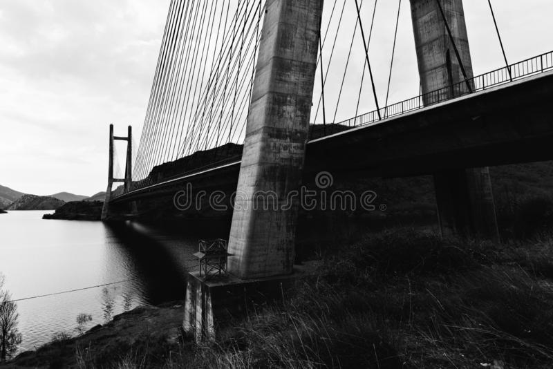 Modern suspension bridge across reservoir Los Barrios de Luna royalty free stock photos