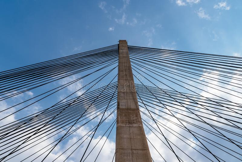 Modern suspension bridge. Detail of tower and steel cables royalty free stock photography