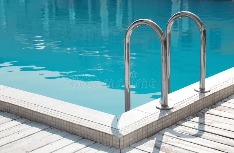 Modern swimming pool with at resort. Modern swimming pool with ladder at resort royalty free stock photos