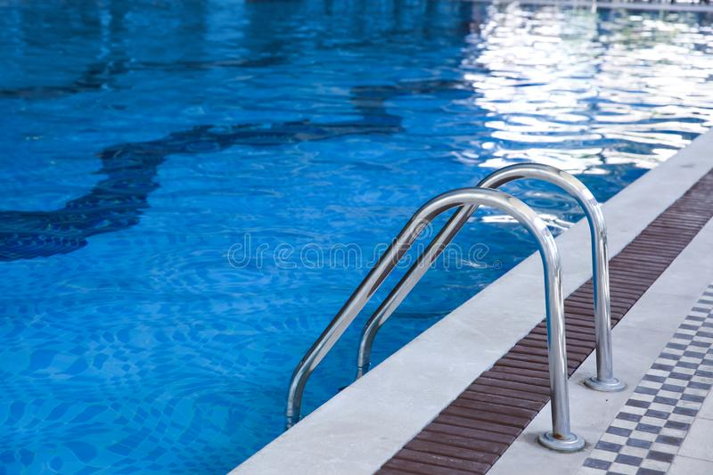 Modern swimming pool with stair royalty free stock images