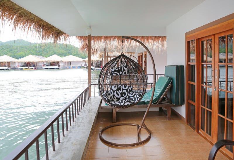 Modern swing on balcony at resort.  stock photo
