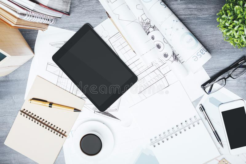 Modern table top with blank touchpad and smartphone royalty free stock photo