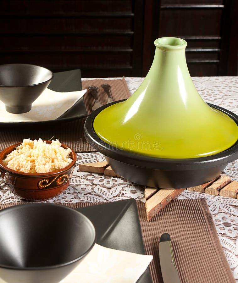 Modern tajine. Pot on a dinner table for moroccan cuisine stock photos