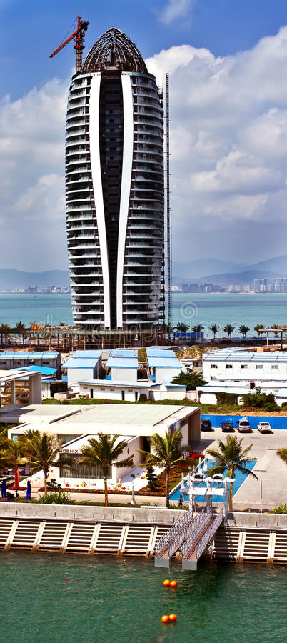 Download Modern Tall Building Under Construction In Sanya Stock Photo - Image: 24059190