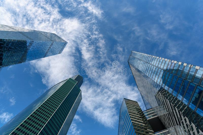 Modern tall office buildings. Skyscrapers in the business district of Moscow City. Business center. Sky and clouds are reflected royalty free stock photos