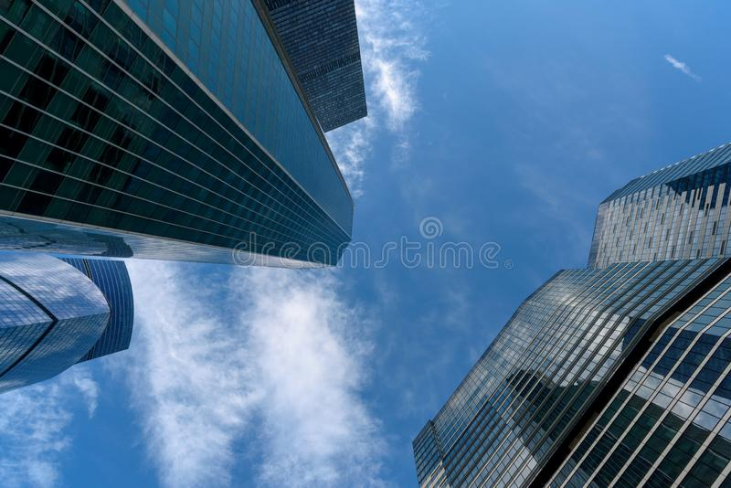 Modern tall office buildings. Skyscrapers in the business district of Moscow City. Business center. Sky and clouds are reflected royalty free stock photo