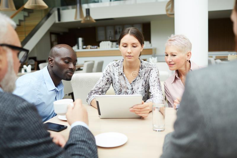 Modern Team of Business People Discussing Work stock image