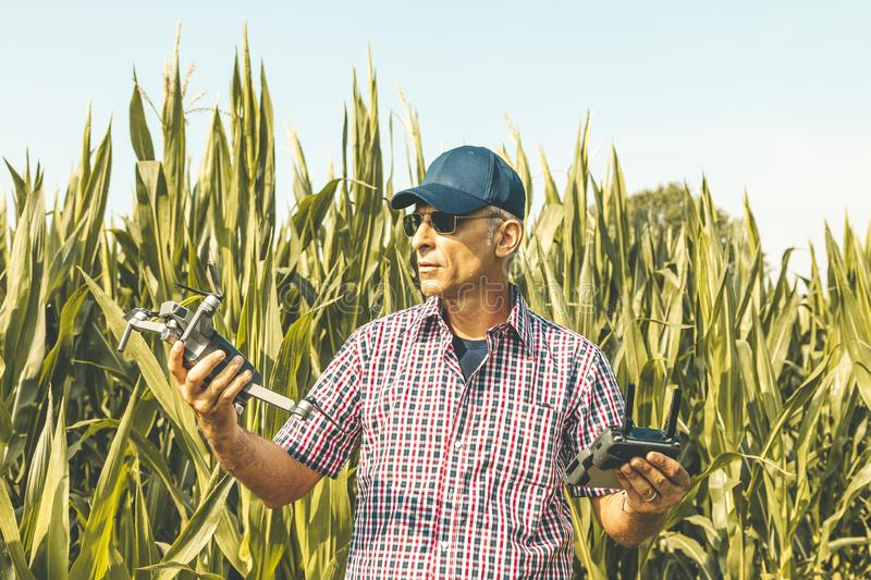 Modern technological farmer as he prepares to fly the drone over his cultivated fields royalty free stock photography