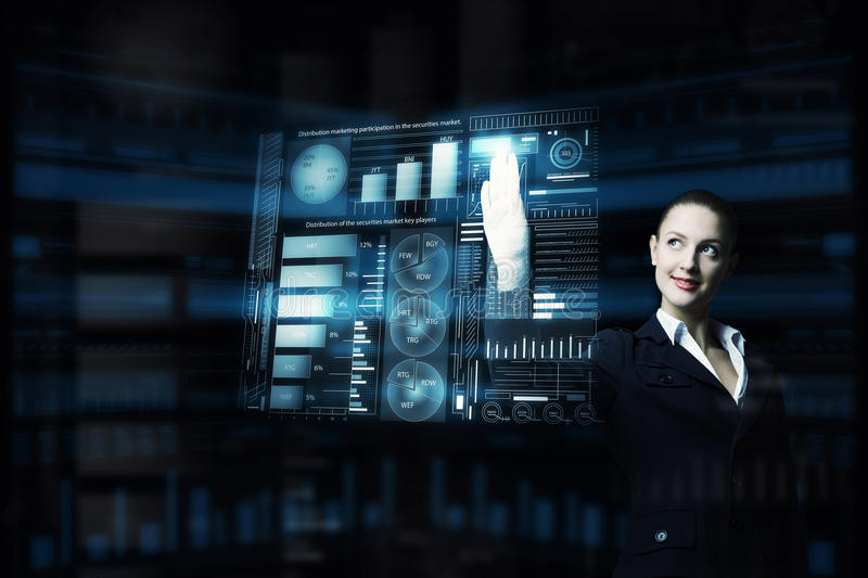 Modern technologies in use. Attractive smiling businesswoman working with virtual panel interface royalty free stock photo