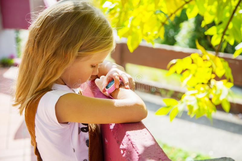 Modern technology for children. School girl using her GPS smart watch.  GPS kids tracker, kids tracking and parental control conce stock photos