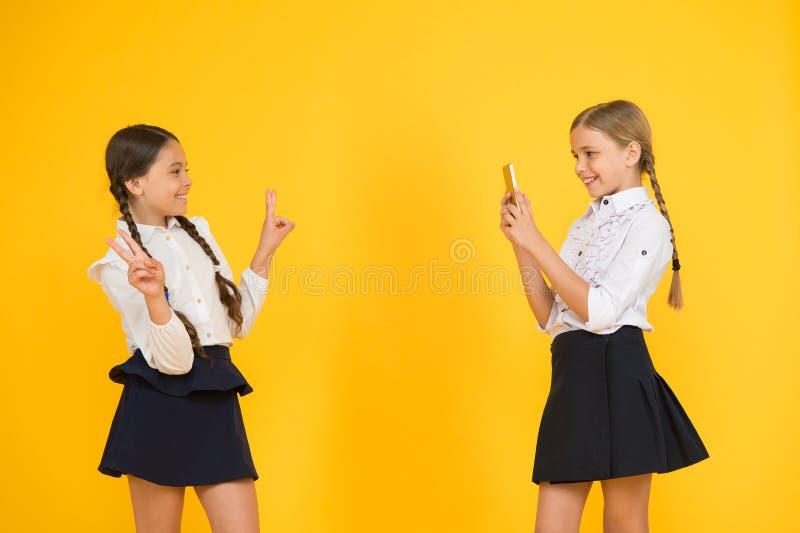 Modern technology. Digital influencer. Little blogger. Blogger school. Schoolgirls use smartphone take photo.Life online. Application smartphone. Personal blog royalty free stock photography