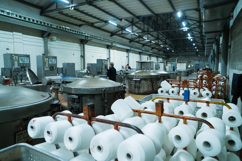 Modern technology in dyeing yarns with Machines for Textile Industry, Dyeing Machine Chemical Tanks.  stock image