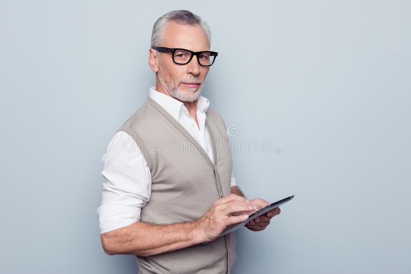 Modern technology leadership people concept. Half-turned portrait of authoritative respectful proud leader man using digital. Gadget at workplace rolled-up royalty free stock images