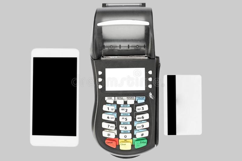 Modern technology and shopping online concept. POS terminal, modern smart phone and credit card isolated on grey background, show. Cashless payment royalty free stock images