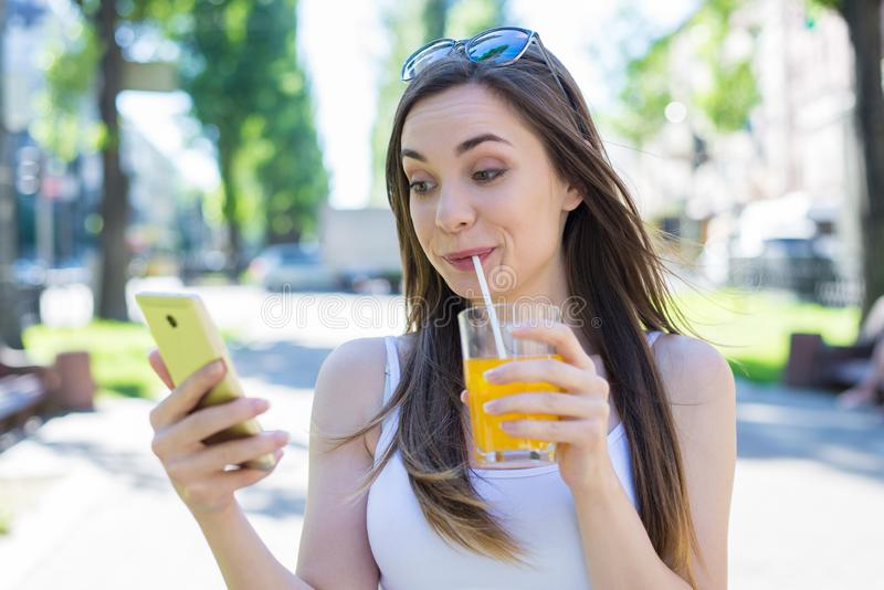 Modern technology teen concept. Closeup photo portrait of funny funky humorous fooling grimacing comic lady holding using stock images