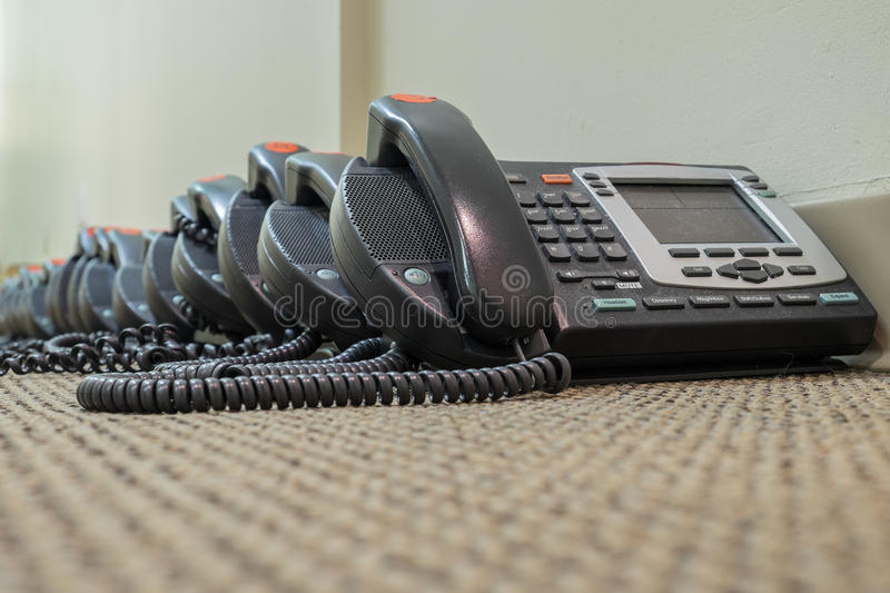 Modern Technology VoIP Telephones sit waiting their deployment. Into new offices royalty free stock images
