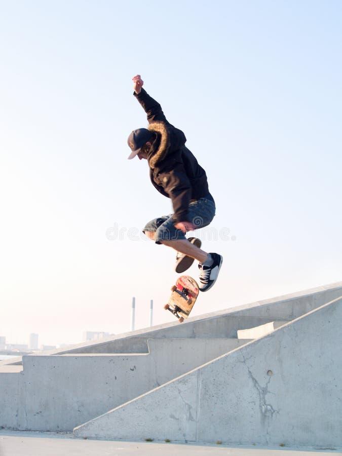 Modern teenage skater catching some air royalty free stock photos