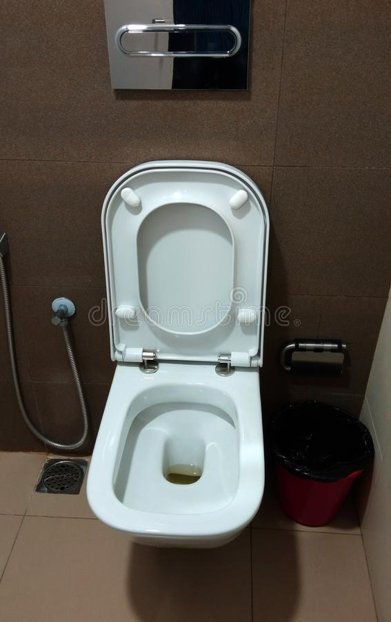 A modern toilet white bowl. royalty free stock images