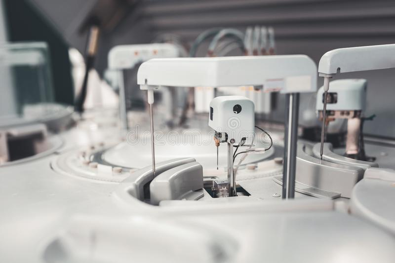 Modern tool for processing blood samples. Laboratory equipment. Close up of modern tool designed for processing blood samples being set in well supplied royalty free stock image