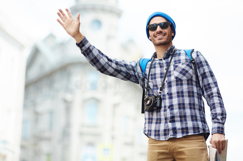 Modern Tourist hailing a Cab stock images