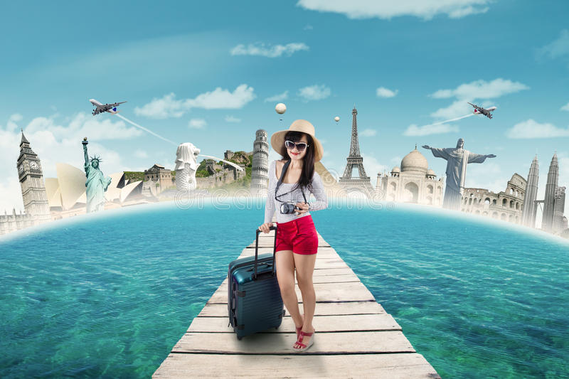 Modern tourist travelling to the world monument stock image