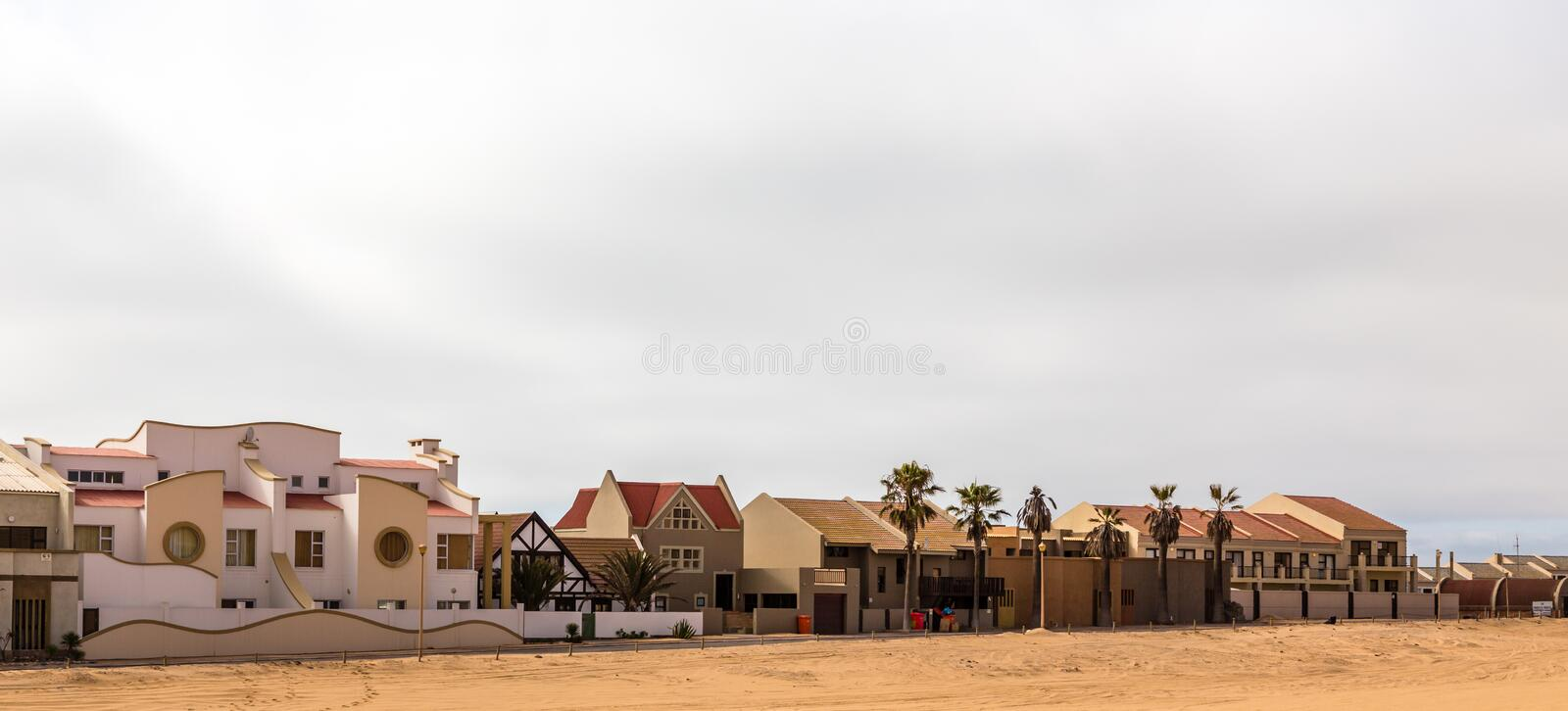 Modern touristic cottages of Dolfynstrand resort at the seaside, close to Walvis Bay, Namibia royalty free stock photos