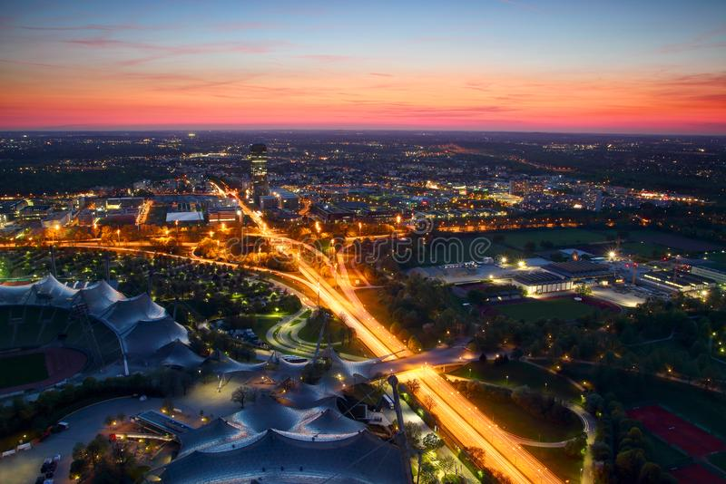 Modern tower blocks, parks and highway junction in blue hour royalty free stock photo