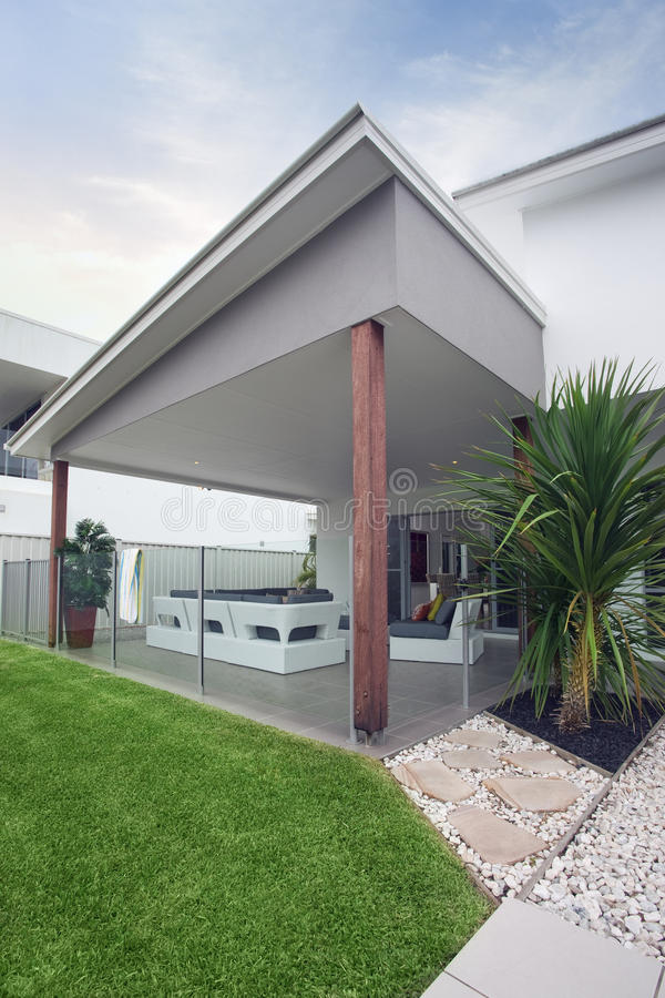 Design Feature On Modern Townhouse With Green Lawn
