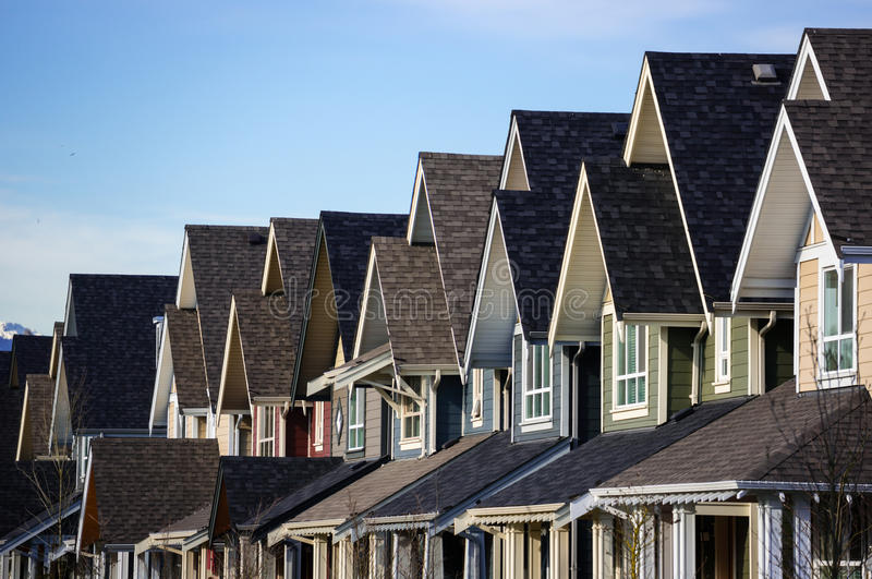 Modern Townhouses. Real estate. A row of new townhouses royalty free stock image