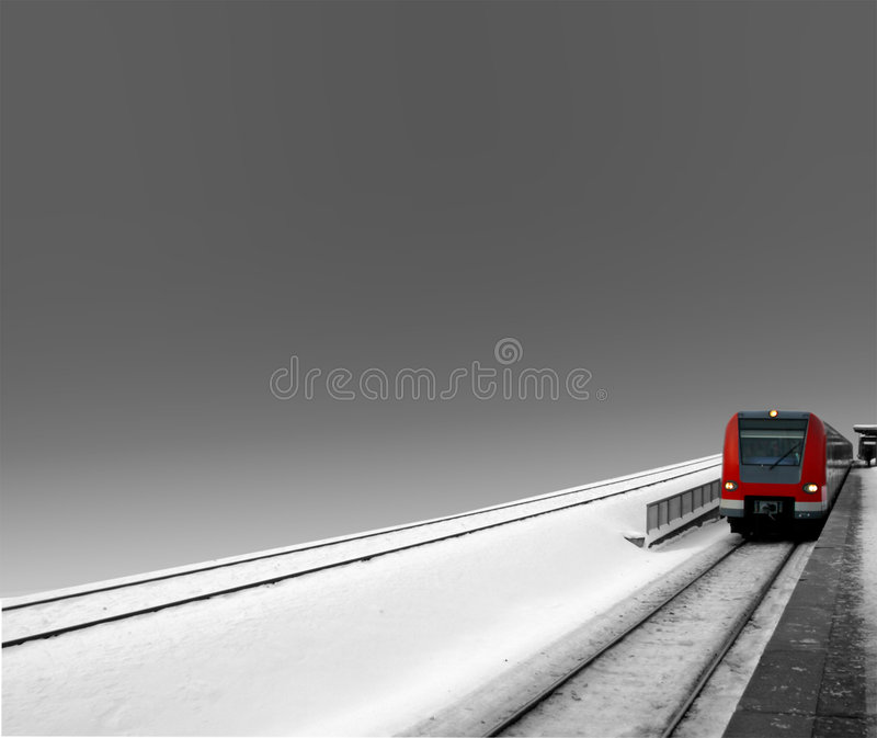 Modern Train. A digitally edited photograph of a modern train set in a monochrome background. The red train is the only object in the photo that is coloured. The royalty free stock image