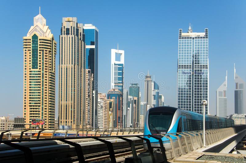 A modern train drive to a station in Dubai, royalty free stock photography
