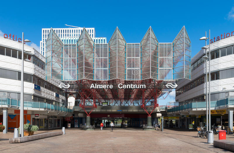 Modern train station. Exterior of the central train station in Almere, Netherlands. The station is opened may 30, 1987 and designed by Peter Kilsdonk. Under the royalty free stock photos