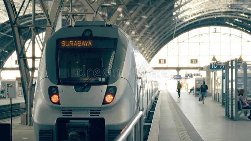 Modern train to Surabaya. Travelling to Indonesia conceptual illustration royalty free stock images