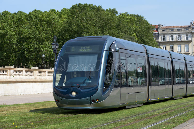 Modern tram in Bordeaux. Bordeaux, France - June 27, 2013: Modern tram in the center of Bordeaux, France on June 27, 2013. The ground-level power supply was stock photography