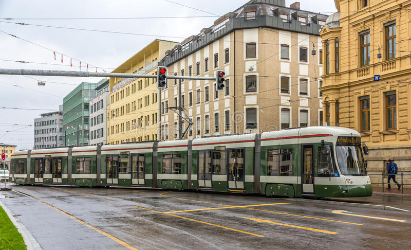 Modern tram on a street of Augsburg - Germany, Bavaria. Modern tram on a street of Augsburg - Germany - Bavaria royalty free stock images