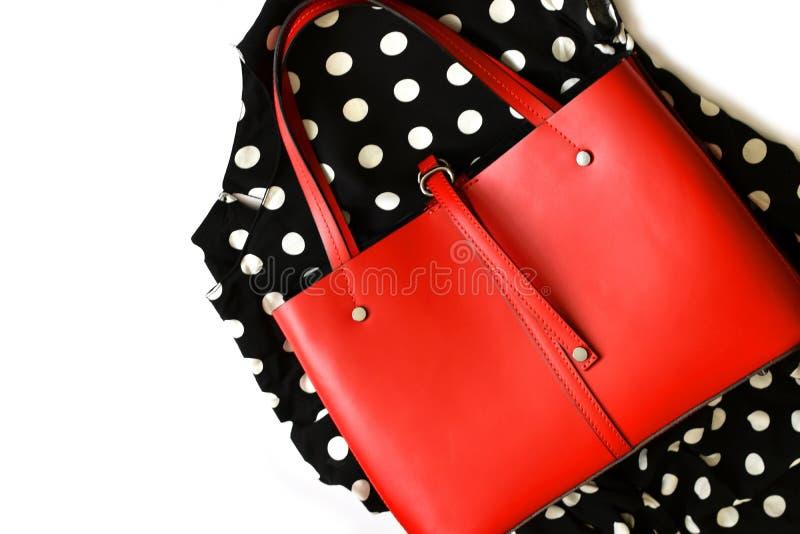 Red leather handbag on polka dot textile stock photography