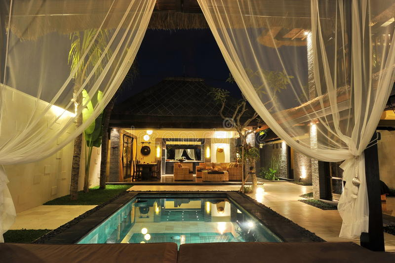 Modern tropical villa with swimming pool. Modern luxury tropical Villa with swimming pool in the nature stock photography