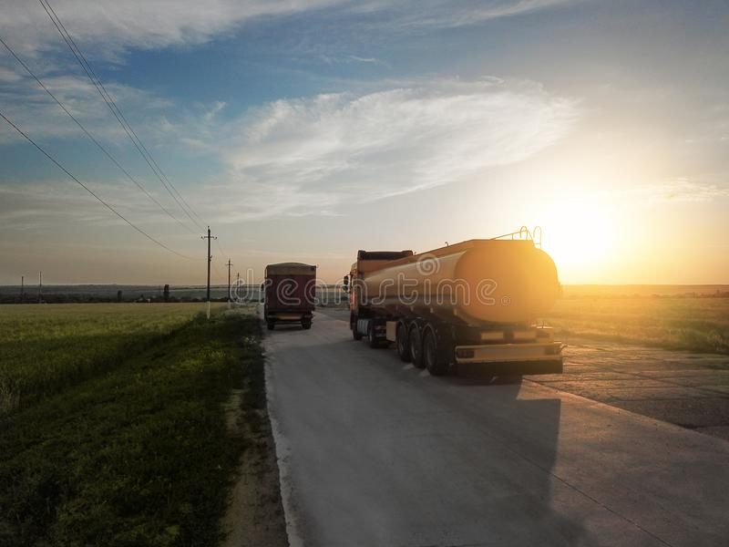 Modern trucks parked on country road. At sunset stock images