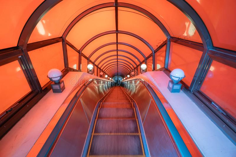 Modern tunnel escalator electronic system moving vintage style, Mechanical escalators for people up and down,. Access detail in stock photography