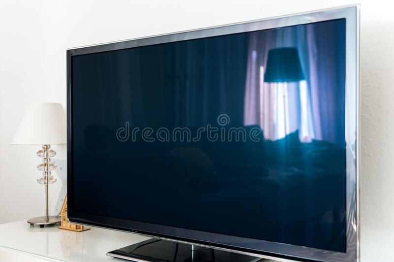 Modern TV Plasma OLED 4k screen in living room stock images